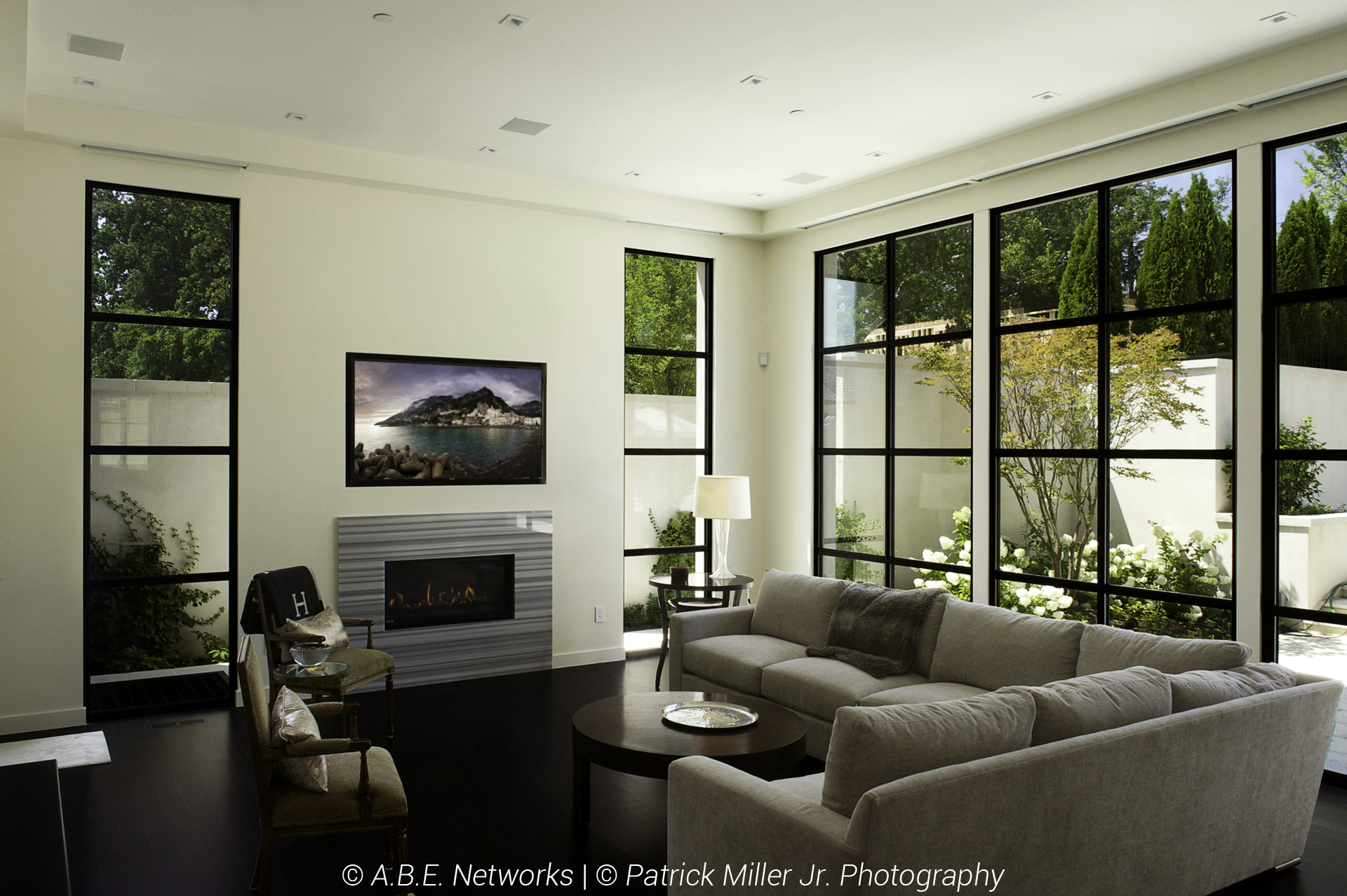 Sonance In-Ceiling Architectural Speakers_In-Wall Niche TV_Lutron Smart Home Lights and Shades_open